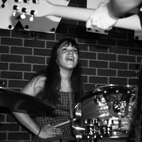 Drummer Hannah Uribe of Cherry Glazerr grins at guitarist Clem in between songs.